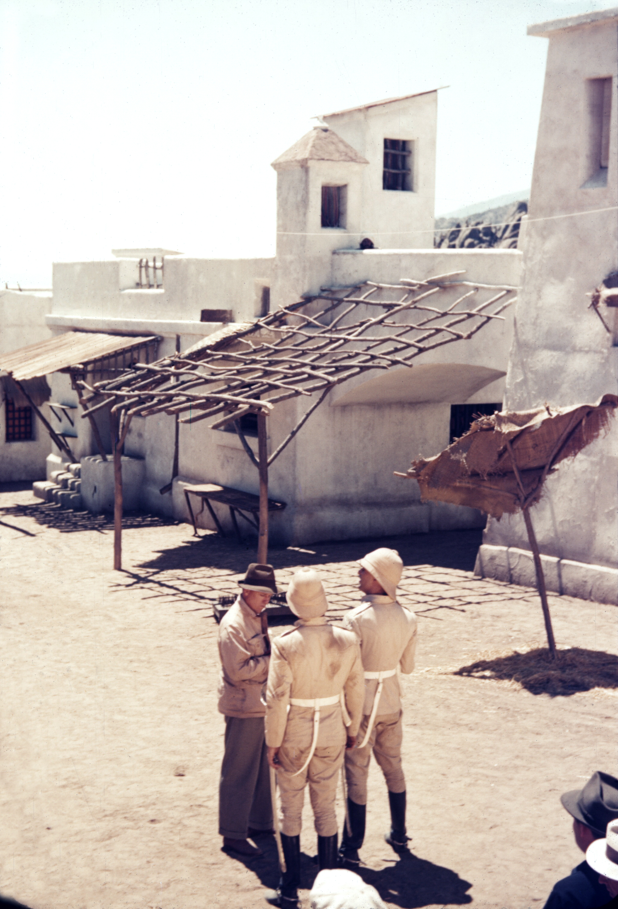 George Stevens (left) converses with Douglas Fairbanks Jr. and Cary Grant on location. (Copyright The Academy of Motion Picture Arts and Sciences)